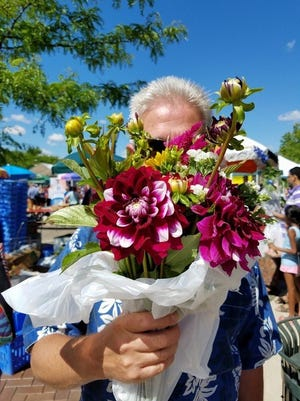 The farmers market is a colorful and inspiring canvas of community life in downtown Farmington.