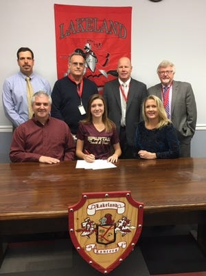 Lakeland Regional High School senior cross country/track standout Samantha Biss signed a National Letter of Intent with St. Thomas Aquinas College this week with family and school administrators in attendance.