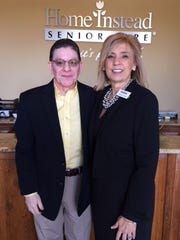 Rev. Paul Matta meets with Wendy Lorenz, general manager