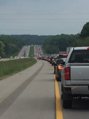 Traffic was backed up for miles Saturday on Interstate 71 between Ohio 95 and Ohio 97 following a fiery, one-car crash in the northbound lanes that resulted in the death of a 19-year-old man.
