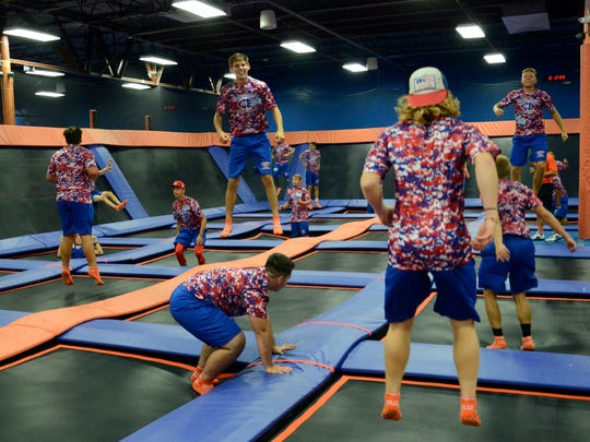 Members of the Cocoa Beach football team get a workout on the trampolines at Sky Zone Trampoline Park in Rockledge.