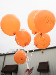Angela Payne from Columbus, Ohio, releases balloons
