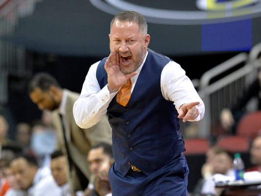 Virginia Tech head coach Buzz Williams shouts instructions to his team during the first half of an NCAA college basketball game against Louisville, Saturday, Jan. 13, 2018, in Louisville, Ky. (AP Photo/Timothy D. Easley)
