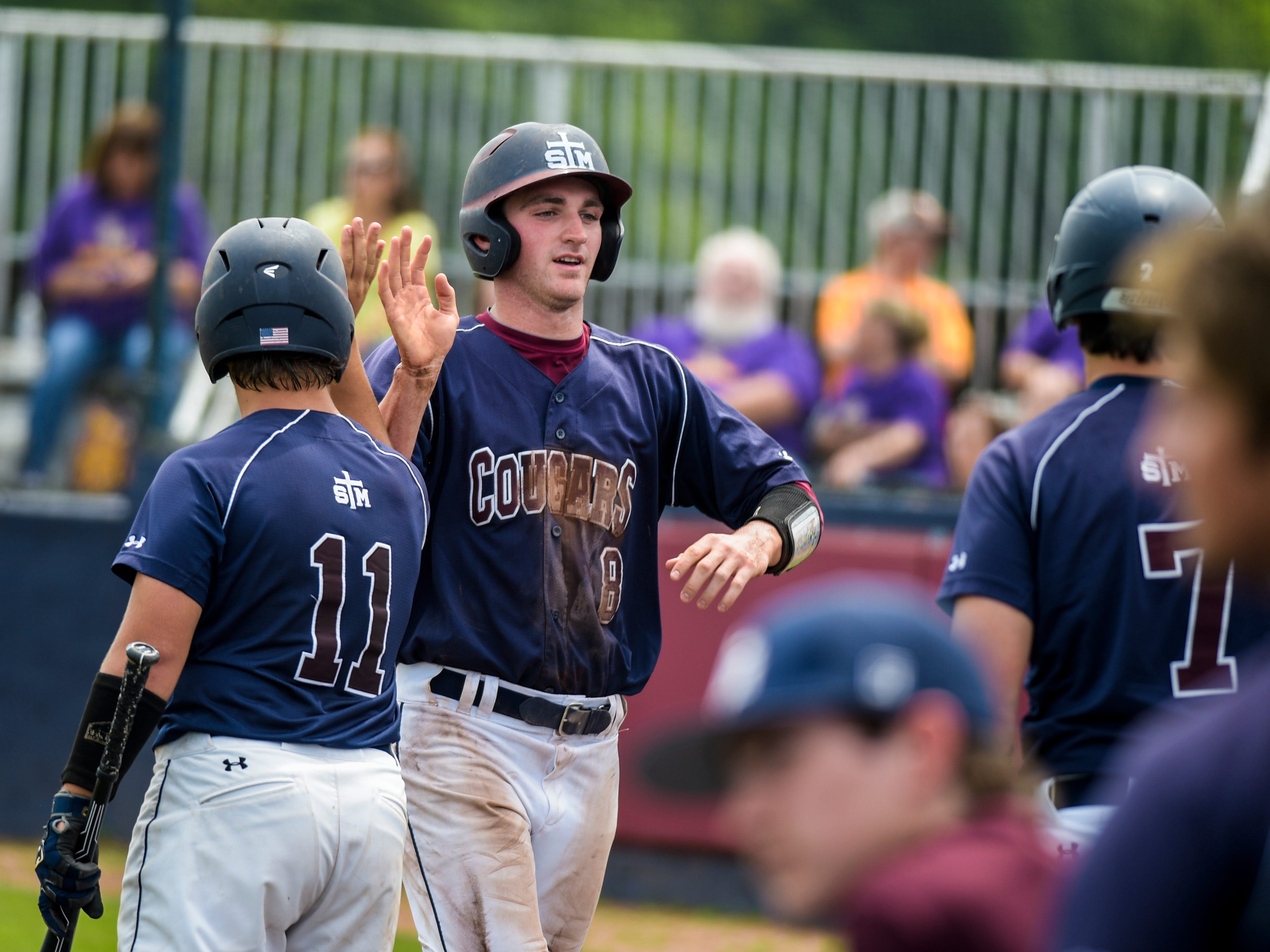 St. Thomas More shortstop O'Neal Lochridge (8), shown here celebrating a run earlier this season, got the game-winning RBI double in Saturday's 4-3 win over Teurlings in Sulphur.