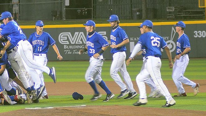 The Santa Barbara Foresters celebrate a 12-3 win over the Cheney Diamond Dawgs Monday night in the championship game of the 86th NBC World Series at Eck Stadium. The Foresters win their eighth NBC title.
