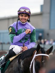 Luis Saez smiles after riding Magnum Moon to victory