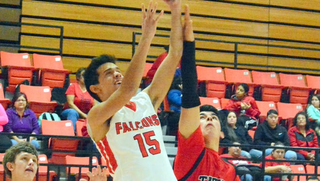 Loving senior wing Freddie Chacon makes a layup in the third quarter Friday