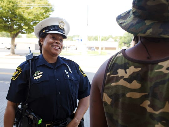 Officer Jennett Vaughn talks with Avondale residents