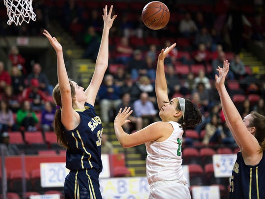 Seton Catholic Central sophomore Marina Maerkl shoots over Susquehanna Valley's Maeve Donnelly in the Section 4 Class B girls basketball title game at Floyd L. Maines Veterans Memorial Arena.