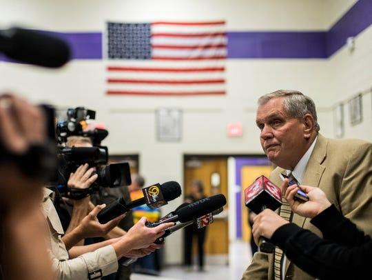Bob Foster speaks to the media after a school board special meeting at Grundy County High School in Coalmont, Tenn. The group discussed continuing the current football season after allegations of hazing and attempted rape surfaced last week.