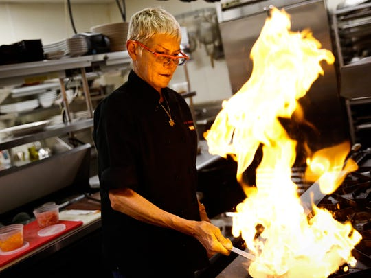 IM Tapas chef Isabel Pozo Polo prepares a dish at her Naples restaurant in September 2015.