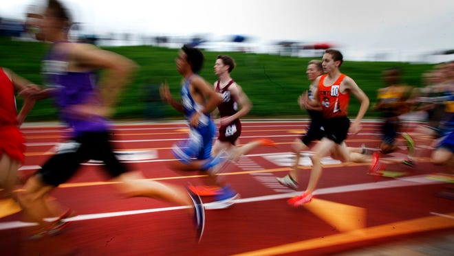 Racers run in the  3200-meters at the 2015 MHSAA Track and Field Div. 1 Finals at Rockford High School on Saturday, May 30, 2015.