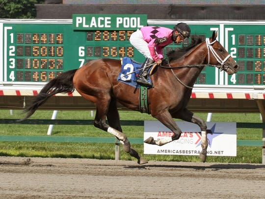Top Clearance, shown winning a race at Monmouth Park earlier this summer, will be one of the longshots taking on American Pharoah in the Haskell Invitational.