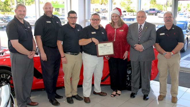 The November Dyer Difference Award for St. Lucie County recognizes New Horizons of the Treasure Coast and Okeechobee. Pictured are Dyer staff members Ken Novander, left, Christian Guyer, Shannon Kinnett and Jonathan Holmes, New Horizons' Lisa Rymer and John Romano and Dyer Chevrolet's Tim Ditullio.
