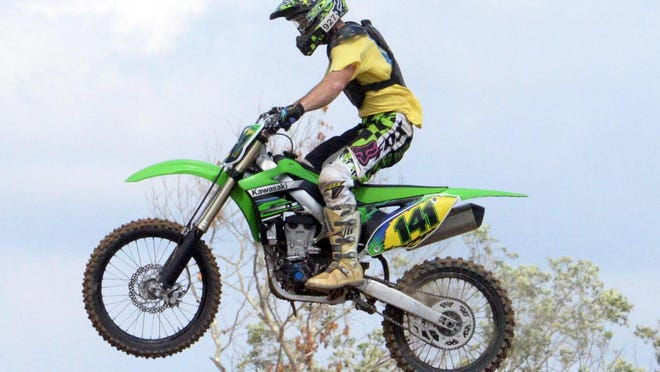 Michael Cox, 26, of Cape May, soars through the air while trying out the Field of Dreams Motocross track in Millville on Friday, September 4, 2014.  Staff photo/Charles J. Olson