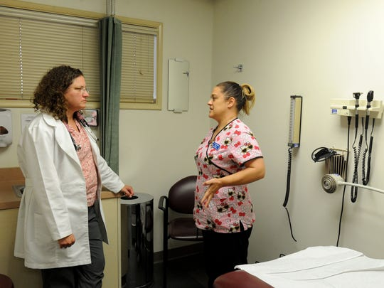 Dr. Sherilyn Wheaton with Primary Medical Group in Ventura talks with April Mason, a medical assistant. Star readers voted the family practice doctor and medical director for an urgent care the winner of this year's hardest worker contest.