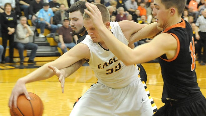 Colonel Crawford's Nick Kemper saves the ball from going out of bounds against Upper Sandusky on Wednesday night.