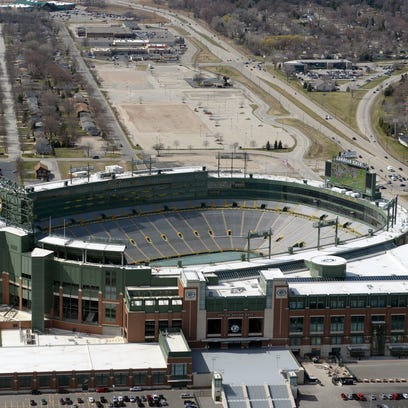 Lambeau Field overlooks the Titletown District, top,