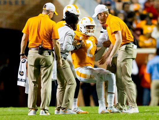 Tennessee quarterback Jarrett Guarantano (2) is helped