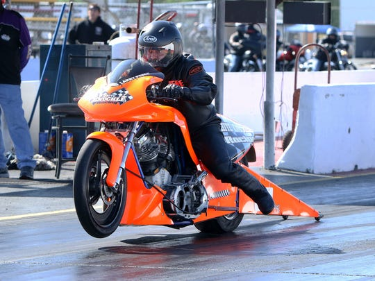 Professional drag racer Larry Pesce is on his 2010 D&G Harley-Davidson custom motorcycle at the State Capitol Raceway near Baton Rouge, Louisiana, on March 28.
