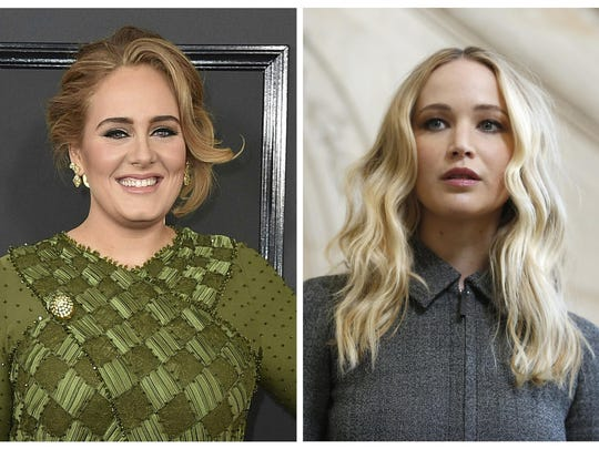 Patrons of the gay bar called Pieces in New York's Greenwich Village were in the right place at the right time when Adele, left, and Jennifer Lawrence showed up Friday night, March 22, 2019.