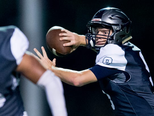 Anderson County's Stanton Martin (9) throws a pass