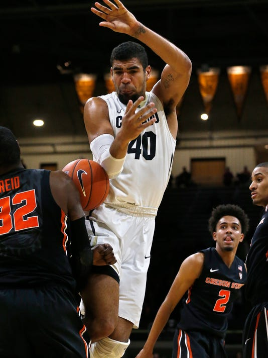 Colorado's Josh Scott (40) is fouled while taking a shot during the first half of an NCAA college basketball game against Oregon State in Boulder, Colo., Wednesday, Jan. 13, 2016. (AP Photo/Brennan Linsley)