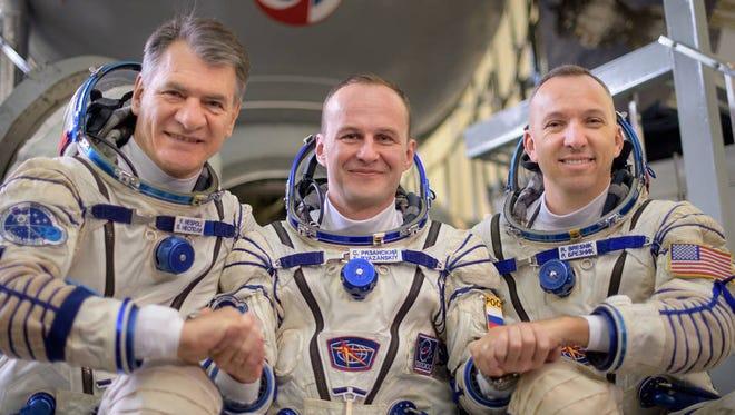 Expedition 52 flight engineers Paolo Nespoli of ESA, left, Sergey Ryazanskiy of Roscosmos, and Randy Bresnik of NASA pictured outside the Soyuz simulator.
