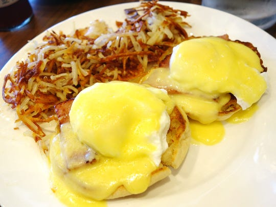 Eggs Benedict with hash browns at Elly's Brunch & Cafe