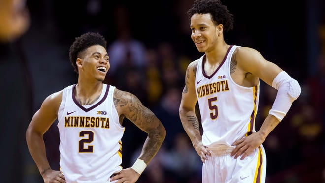 Minnesota Gophers guards Nate Mason, left, and Amir Coffey, right, laugh in the second half of their win over Ohio State on Sunday. The Gophers have had lot to smile about this Big Ten season. Wins at Purdue and Northwestern have them unexpectedly as the highest-rated team in the league.