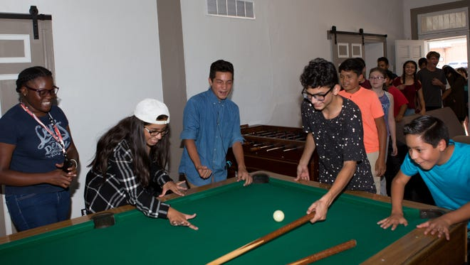 Las Cruces Boys & Girls Club members check out a new pool table in the renovated Club Teen Center at the club on Monday, July 10, 2017..The teen members were told the former storage space would become offices, but were happy to find out it was a new area for teens.
