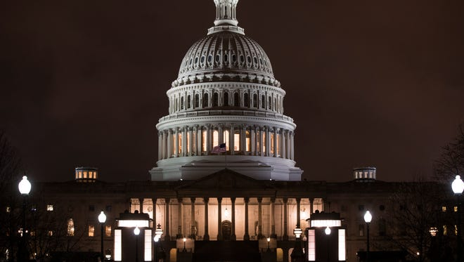 The U.S. Capitol is seen before dawn Wednesday. Congress is considering reform for the Dodd-Frank Act.