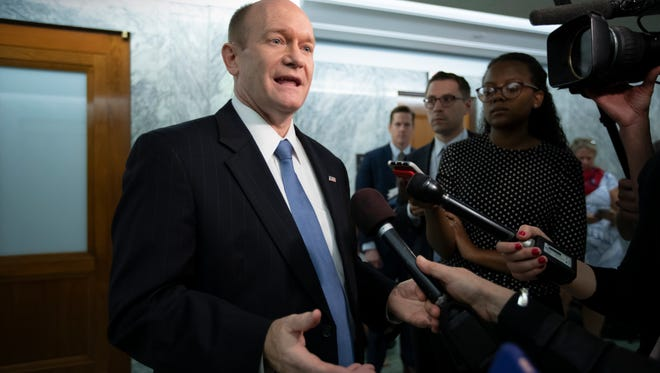 Sen. Chris Coons, D-Del., a member of the Senate Foreign Relations Committee and the Judiciary Committee, responds to reporters asking about President Donald Trump's diplomatic travels at the G-7 in Canada and the summit with the leader of North Korea in Singapore, on Capitol Hill in Washington, Tuesday, June 12, 2018.