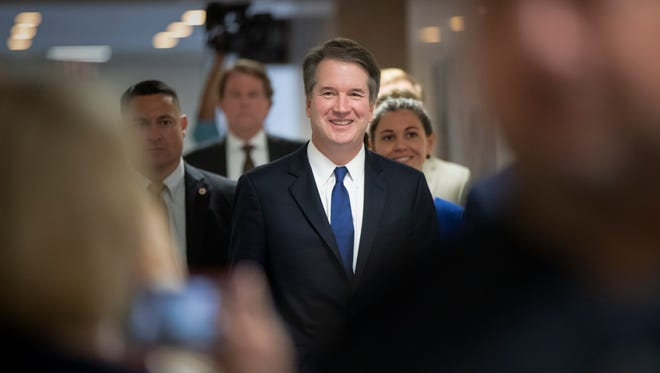 Supreme Court nominee Judge Brett Kavanaugh, President Donald Trump's choice to replace retiring Justice Anthony Kennedy, arrives for a private meeting with Sen. Joe Manchin, D-W.Va., a member of the Judiciary Committee, on Capitol Hill in Washington, Monday, July 30, 2018.