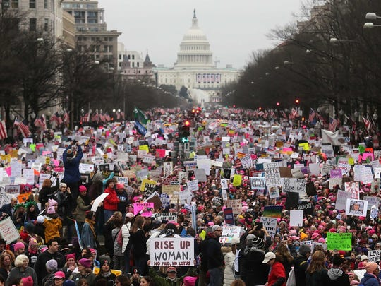 Protesters flood the streets during the Women's March on Washington, with the U.S. Capitol in the background, on January 21, 2017 in Washington, D.C.