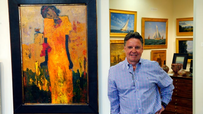 "David Griswold stands next to ""Breaking Into Blossom"" by Goli at the Beacon Fine Arts Gallery on Monmouth Street in Red Bank Monday, May 2, 2016."