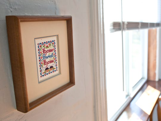 """A frame in the kitchen reads """"Home Sweet Home"""" Wednesday, November 4, 2015 at Kristen and Joseph Murphy's home in Port Huron Township. The couple is waiting on a final OK to become foster parents."""