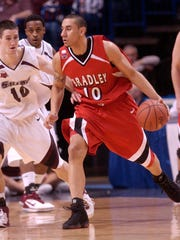 Bradley's JJ Tauai handles the ball for the Braves against Southern Illinois during a Missouri Valley Conference Tournament game in 2007.