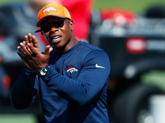 FILE - In this Wednesday, Aug. 2, 2017, file photo, Denver Broncos head coach Vance Joseph directs players during drills at an NFL football camp in Englewood, Colo. General manager John Elway decided to stick with coach Vance Joseph despite the Broncos' most disappointing season in decades, one that began with a 3-1 start but crumbled to a 5-11 finish. (AP Photo/David Zalubowski, File)