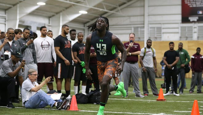 Former Mississippi State wide receiver De'Runnya Wilson improved his time in the 40-yard dash on Thursday.