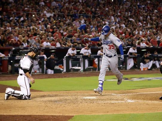 Dodgers first baseman Cody Bellinger hits a home run