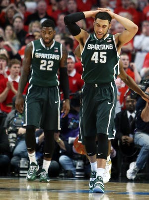 Michigan State's Denzel Valentine, right, and Branden Dawson react during the second half of today's championship game of the Big Ten Tournament against Wisconsin Badgers at United Center.