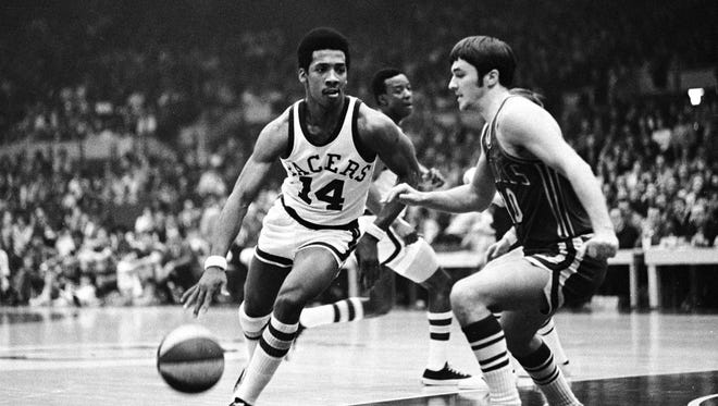 Indiana Pacer Freddie Lewis (14) outpaced Kentucky's Louie Dampier in the Pacers 109-107 victory, Feb. 8, 2017. It was the eighth straight victory over the Colonels.