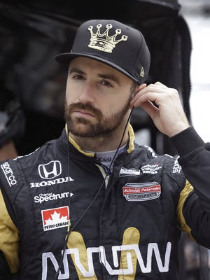 IndyCar driver James Hinchcliffe prepares himself for the morning practice for the Angie's List Grand Prix of Indianapolis Saturday, May 14, 2016, at the Indianapolis Motor Speedway.