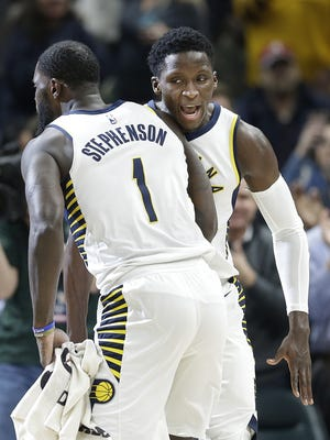 Indiana Pacers guard Victor Oladipo (4) celebrates with Lance Stephenson (1) following their game at Bankers Life Fieldhouse Wednesday, Dec 6, 2017. The Indiana Pacers defeated the Chicago Bulls 98-96.