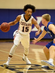 Lebanon's Sincere Scott brings the ball down court as Lebanon and Cedar Crest faced off in the championship game of the Lebanon Tip-Off Tournament Sat. night, Dec. 9. The Falcons defeated the Cedars 49-46.