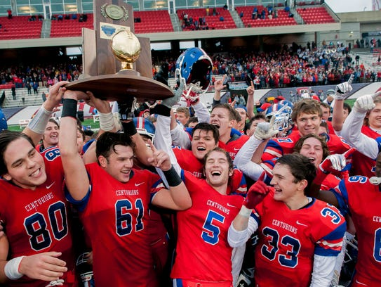 Christian Academy-Louisville players celebrate after