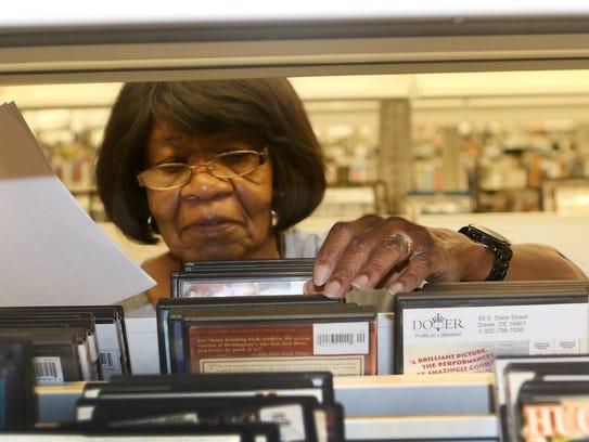 Dover Public Library volunteer Beatrice Whitworth puts