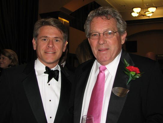Johnny Danos, right, and attorney Chris Pose attended the Iowa Business Hall of Fame black tie dinner in 2007.