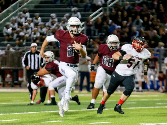 Flour Bluff quarterback Jaeger Bull (2) has room to run on the keeper against San Antonio Southside in the 5A Division I bi-district playoff game at Hornet Stadium in Flour Bluff on Friday, Nov. 11, 2016.